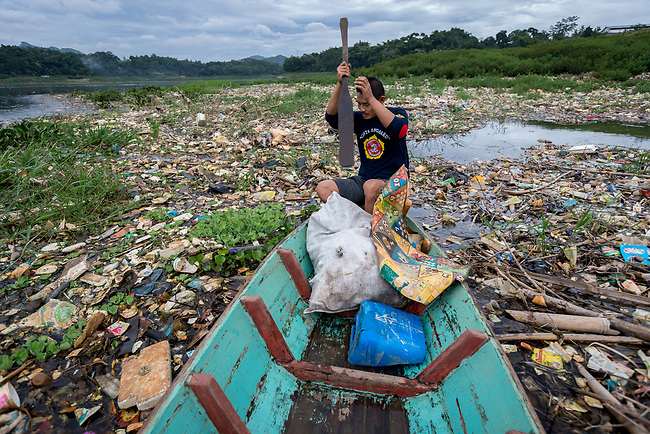 29 JAN, 2018, Bandung, Indonesia:  Boatman and rubbish scavenger Asep Satia Permana navigates through the polluted Citarum river at Cihampelas village down from Saguling dam outside Bandung, Indonesia. The river is listed as one of the most polluted rivers in the world.  It will soon be the main water supply system for Jakarta as the bores that have been dug into the aquifers dry but it also supports agriculture, fishery, industry, sewerage and electricity.  The Indonesian Government is moving to urgently try to clean the system up but it is fighting massive infrastructure issues and toxic industrial dumping.    Picture by Graham Crouch/The Australian