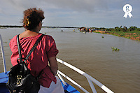 Woman contemplating scenics on Mekong River (Licence this image exclusively with Getty: http://www.gettyimages.com/detail/94433089 )