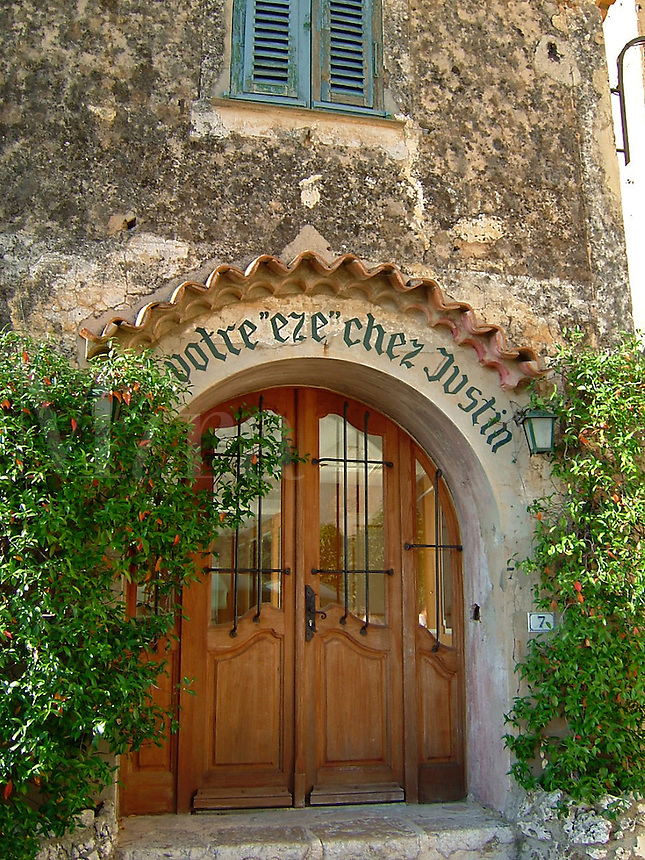Eze, France, an ancient town built into rock on the southern coast of France, between Nice and Monte Carlo, Monaco. Votre eze chez Justin is a play on words. Aise means ease.  Thus, Your ease at Justin's.