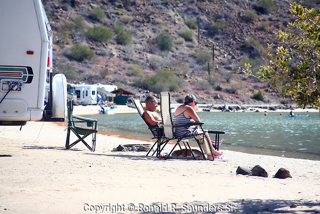 SENIOR COUPLE RELAX on BEACH and LAKE
