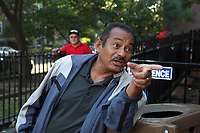 (171015RREI5541) La Esquina where Latinos have gathered for decades at the corner of Mt. Pleasant St. and Kenyon St. NW. to play chekers (damas). Oscar Hernandez (center), Leiva in background. Washington DC Oct. 15 ,2017 . ©  Rick Reinhard  2017     email   rick@rickreinhard.com