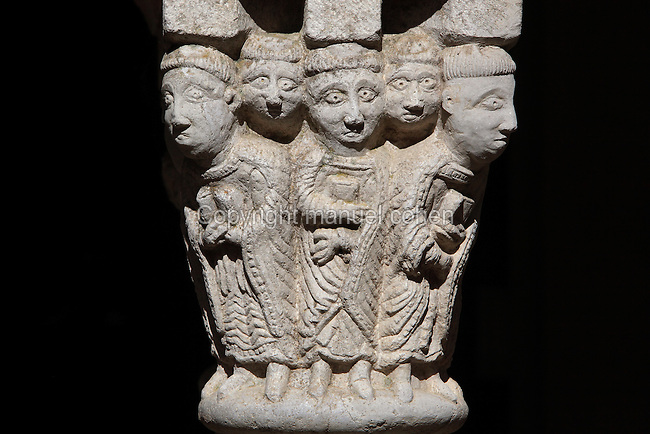 Carved stone capital from the 12th century Romanesque cloister, depicting monks holding prayer books with staring eyes, at Sant Pere de Rodes, a Benedictine monastery on the Verdera mountain in the Sierra de Rodes, Puerto de la Selva, Girona, Catalonia, Spain. The monastery itself was founded in 945 by monks who escaped Barbarian invasions with relics of saints, and was eventually sacked in the 17th century and deserted in the 18th century. Picture by Manuel Cohen