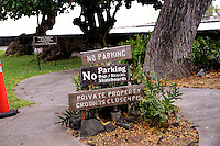 Signs announcing No Parking, No Dogs, No Bicycles, and No Skateboards. Hulihe'e Palace, Kailua-Kona, Big Island, Hawaii