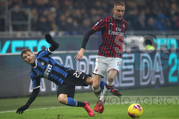 Andrea Conti of AC Milan bundles over Nicolo Barella of Inter during the Serie A match at Giuseppe Meazza, Milan. Picture date: 9th February 2020. Picture credit should read: Jonathan Moscrop/Sportimage