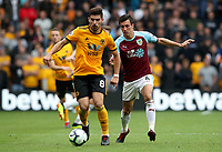 Wolverhampton Wanderers' Ruben Neves and Burnley's Jack Cork<br /> <br /> Photographer Rachel Holborn/CameraSport<br /> <br /> The Premier League - Wolverhampton Wanderers v Burnley - Sunday 16th September 2018 - Molineux - Wolverhampton<br /> <br /> World Copyright &copy; 2018 CameraSport. All rights reserved. 43 Linden Ave. Countesthorpe. Leicester. England. LE8 5PG - Tel: +44 (0) 116 277 4147 - admin@camerasport.com - www.camerasport.com