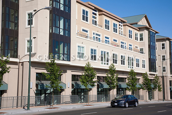 A facade of a multi use building. Park Broadway on El Camino Real in Millbrae, CA is a mixed use development featuring 96 residential condominiums and 13 ground floor live-work lofts for small business offices. The developer Silverstone Communities promotes energy efficient features such as dual-glazed low-emission windows, high-density thermal insulation, individual electric meters, HVAC systems for each unit, and energy-efficient heating systems. Park Broadway is walking distance to downtown amenities.