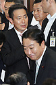 August 26, 2011, Tokyo, Japan - Japans Finance Minister Yoshihik Noda exchange greetings with his fellow legislators at a meeting of Democratic Party of Japan lawmakers, where unpopular Prime Minister Naoto Kan announces his resignation in Tokyo on Friday, August 26, 2011. Background is former Foreign Minister Seiji Maehara..Kans departure will pave the way for the ruling party to select his successor in a race among seven mediocre candidates slated for August 29. The election pits Noda against Maehara for the party leadership and that of the country - sixth in five years. (Photo by AFLO).