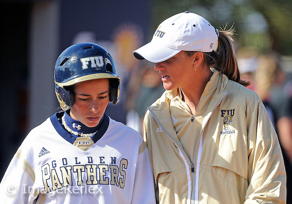 Florida International University infielder Jessy Alfonso (8) listens to Head Coach Beth McClendon during the game against Southern Illinois University.  FIU won the game 10-6 on February 13, 2010 at Miami, Florida. .