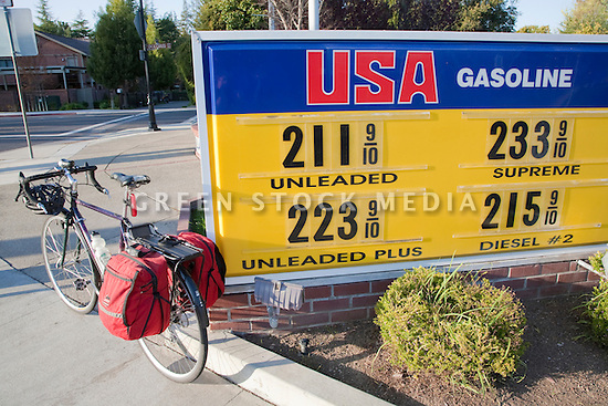 A commuter bicycle beside an USA Gasoline gas station price sign on March 24, 2009. Los Altos, California, USA