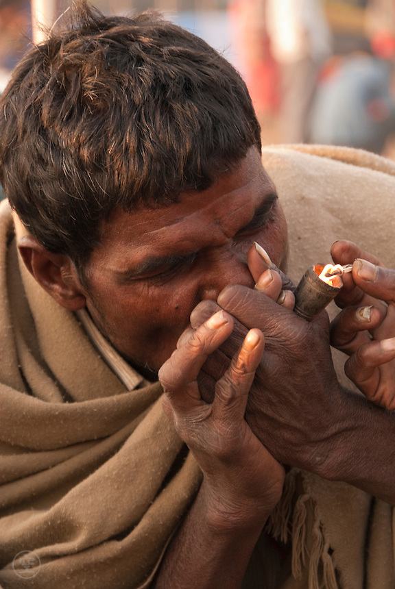 An Indian Man lights a celebratory pipe at the end of the Janadesh March for Land, 2007.