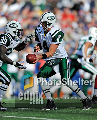 2 November 2008:  New York Jets' quarterback Brett Favre (4) hands off to running back Leon Washington during a game against the Buffalo Bills at Ralph Wilson Stadium in Orchard Park, NY. The Jets defeated the Bills 26-17 improving their record to 5 and 3 for the season...Mandatory Photo Credit: Ed Wolfstein Photo