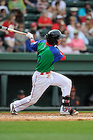 Shortstop Mauricio Dubon (10) of the Greenville Drive bats in a game against the Augusta GreenJackets on Sunday, April 12, 2015, at Fluor Field at the West End in Greenville, South Carolina. Augusta won, 2-1. (Tom Priddy/Four Seam Images)