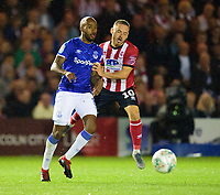 Lincoln City's Jack Payne vies for possession with Everton's Fabian Delph<br /> <br /> Photographer Andrew Vaughan/CameraSport<br /> <br /> The Carabao Cup Second Round - Lincoln City v Everton - Wednesday 28th August 2019 - Sincil Bank - Lincoln<br />  <br /> World Copyright © 2019 CameraSport. All rights reserved. 43 Linden Ave. Countesthorpe. Leicester. England. LE8 5PG - Tel: +44 (0) 116 277 4147 - admin@camerasport.com - www.camerasport.com