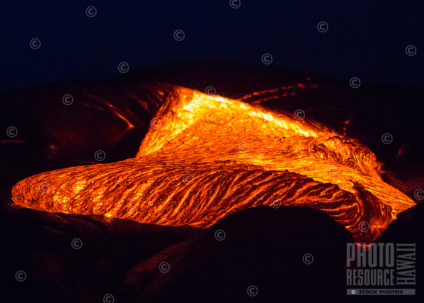 New Crust: Molten lava crusts just before dawn on the 61g flow field, Hawai'i Volcanoes National Park, Big Island.