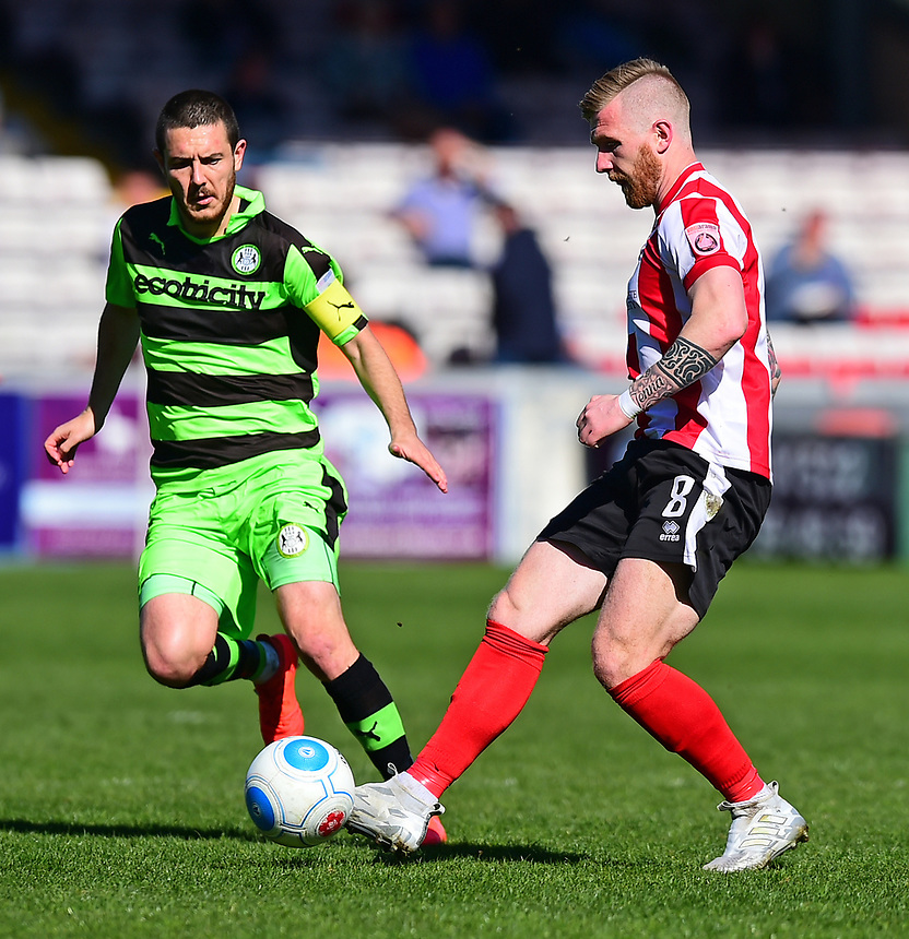 Lincoln City's Alan Power vies for possession with Forest Green Rovers' Liam Noble<br /> <br /> Photographer Andrew Vaughan/CameraSport<br /> <br /> Vanarama National League - Lincoln City v Forest Green Rovers - Saturday 25th March 2017 - Sincil Bank - Lincoln<br /> <br /> World Copyright &copy; 2017 CameraSport. All rights reserved. 43 Linden Ave. Countesthorpe. Leicester. England. LE8 5PG - Tel: +44 (0) 116 277 4147 - admin@camerasport.com - www.camerasport.com