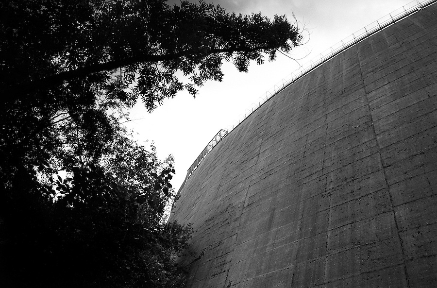 The Vajont Dam still intact today as seen from underneath. On October 9th 1963 a giant landslide collapses into the artificial lake created by the Vajont Dam in northern Italy, provoking a 250 meters high wave that completely destroys the settlements near the lake and the town of Longarone far down in the valley below the dam. 1910 people lost their lives in a tragedy that easily could have been avoided if it was not for the economical and political interests of powerful men dreaming of the tallest dam in the world. A tragedy that is still alive today in Erto, Casso and Longarone, where the survivers of that disastrous day almost 50 years ago are still fighting for their justice.