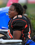 St. Louis Slam's Pamela Green is from Fairview Heights. Here, she takes a break on the sidelines.