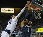 Nevada forward Caleb Martin (10) blocks the shot of                      Akron's Tyler Cheese (4) in the second half of an NCAA college basketball game in Reno, Nev., Saturday, Dec. 22, 2018. (AP Photo/Tom R. Smedes)