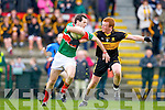Crokes midfielderJohnny Buckley chellenges Ciaran McGrath Loughmore/Castleiney during the Munster Club championships in Killarney on Saturday