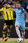 Borussia Dortmund midfielder Christian Pulisic (l) fights for the ball with Manchester City defender Aleksandar Kolarov (r) during the match against Manchester City FC at the 2016 International Champions Cup China match at the Shenzhen Stadium on 28 July 2016 in Shenzhen, China. Photo by Victor Fraile / Power Sport Images