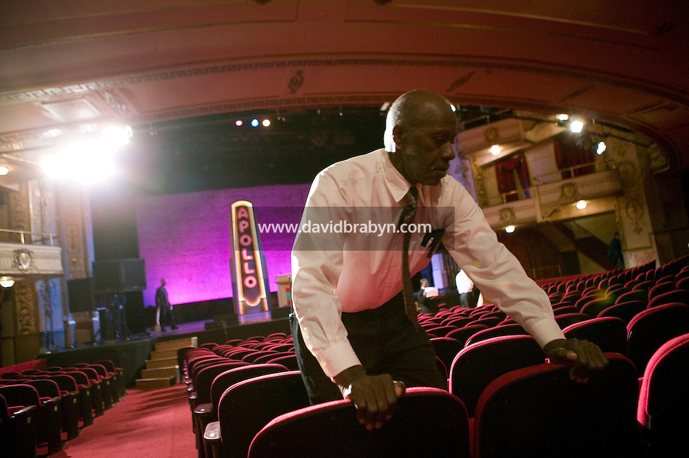 13 February 2006 - New York City, NY - An employee checks the new seats at the Apollo theater in Harlem, New York City, USA, 13 February 2006. The famous theater, home of the Amateur Nights at The Apollo, is reopening with a renovated faade and new seats.