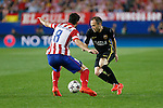 FC Barcelona´s Andres Iniesta (R) during a second leg quarterfinal Champions League soccer match between Atletico de Madrid and FC Barcelona at Vicente Calderon stadium in Madrid, Spain. April 09, 2014. (ALTERPHOTOS/Victor Blanco)