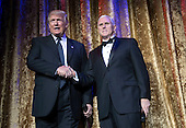 United States President-Elect Donald Trump and Vice President-Elect Gov. Mike Pence (R-IN) arrive together to deliver remarks at the Chairman's Global Dinner, at the Andrew W. Mellon Auditorium in Washington, D.C. on January 17, 2017. The invitation only black-tie event is a chance for Trump to introduce himself and members of his cabinet to foreign diplomats.  <br /> Credit: Kevin Dietsch / Pool via CNP