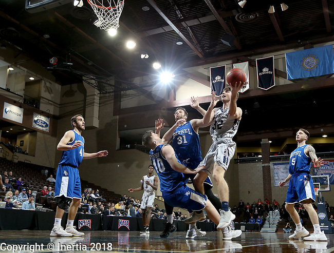 SIOUX FALLS, SD - MARCH 7:  Janson Lietkze #32 from Oklahoma Wesleyan shoots over Kyle Thompson #40 and Luke Fisher #31 from Bethel at the 2018 NAIA DII Men's Basketball Championship at the Sanford Pentagon in Sioux Falls. (Photo by Dave Eggen/Inertia)
