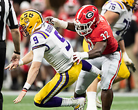 ATLANTA, GA - DECEMBER 7: Joe Burrow #9 of the LSU Tigers is put under pressure by Monty Rice #32 of the Georgia Bulldogs during a game between Georgia Bulldogs and LSU Tigers at Mercedes Benz Stadium on December 7, 2019 in Atlanta, Georgia.