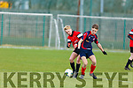 Odhran Ferris of Park FC keeps his eye on the ball despite the attention of Killian Smyth of Kells Blackwater in the U15 National Cup Quarter Final