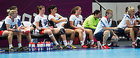 25 JUL 2012 - LONDON, GBR - Great Britain Head Coach Jesper Holmris (GBR) (kneeling, second from right) watches play during the women's London 2012 Olympic Games warm up handball match against Spain at The Copper Box in the Olympic Park, in Stratford, London, Great Britain (PHOTO (C) 2012 NIGEL FARROW)
