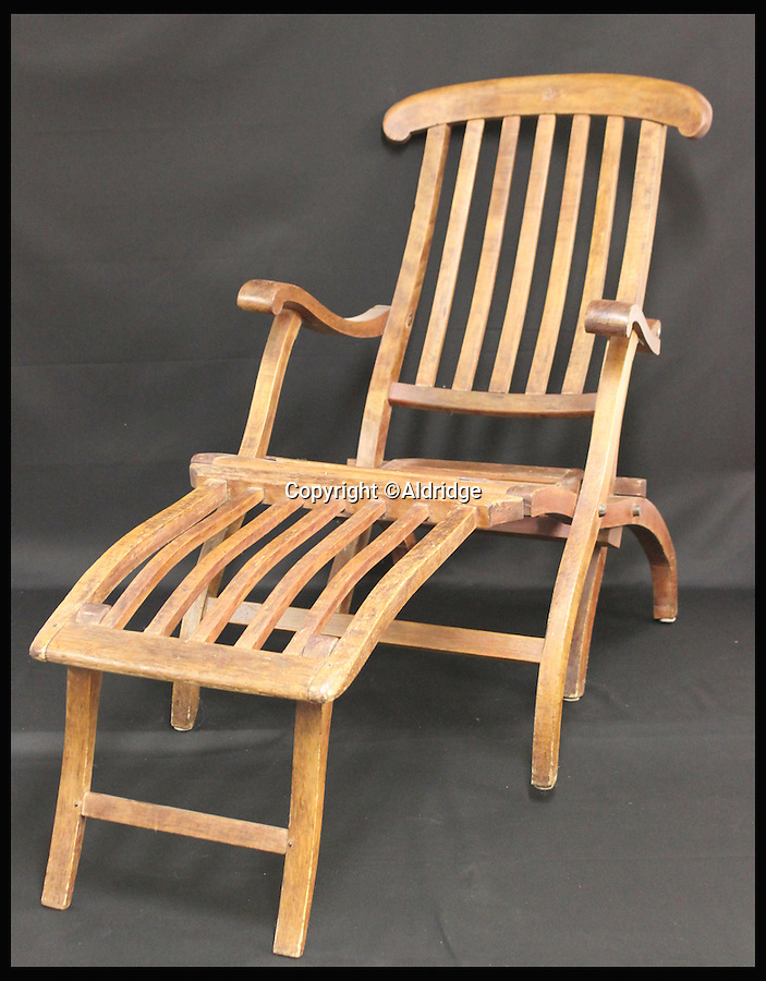 BNPS.co.uk (01202 558833)<br /> Pic: Aldridge/BNPS<br /> <br /> *Please use full byline*<br /> <br /> The deck chair.  Expected to sell for £80,000.<br /> <br /> An incredibly rare deckchair that was recovered from the wreck site of the Titanic has surfaced for sale 103 years later.<br /> <br /> The collapsible chair graced the first class promenade deck of the luxury liner and was washed overboard when the ship sank after hitting an iceberg on its maiden voyage in 1912.<br /> <br /> The wooden item was found bobbing on the surface of the Atlantic by the crew of the Mackay-Bennett, the ship given the grim task of recovering the bodies of the victims in the wake of the tragedy.