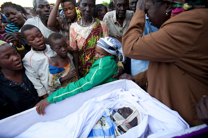 18 may 2010 - Yambio, Western Equatoria State, South Sudan - Relatives and community cry at the funeral of Gabriel Makana. Three Sudanese were brutally murdered when their car was ambushed by the Lord's Resistance Army (LRA) on the road just few miles from Tambura on May 17, 2010. The victims were government officials in the State Ministry of Education: Mr. William Arkangelo Baabe, Mr. Gabriel Makana (49 years old) and Baraka Josefati (25 years old). Over the weekend 30 to 40 LRA attacked five miles north of the town of Tambura, close to the borders with the Central African Republic and the Democratic Republic of the Congo. The LRA group ransacked a medical center, looted food and other items, and abducted seven people. Western Equatoria state has been rocked by LRA activities since 2006. Thousands of people have been forced from their homes as brutal attacks continue against the civilian population in the region and neighboring DRC and CAR. Photo credit: Benedicte Desrus