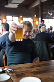 CANADA, Vancouver, British Columbia, green architect and outdoor adventurer Michael Green having a beer at Cardero's Restaurant on Coal Harbour Quay