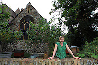 "Camilla Goddart, 38 years old, posing in front of her first hive in the garden of St Peters Church in Brocley where she started 8 years ago. Since, this graphic designer by training created a company, ""Capital Bee"", that sells honey in the markets or in shops and cafÈs like Broca Market, Brockley, The Frog on the Green Deli in Nunhead, Cafe Crema in New Cross and El's Kitchen in Ladywell.<br />