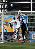 Joe Cannon (right) makes the save over Galaxy players and an Earthquakes defender. San Jose Earthquakes defeated LA Galaxy 2-1 at the Oakland-Alameda County Coliseum in Oakland, California on June 20, 2009.
