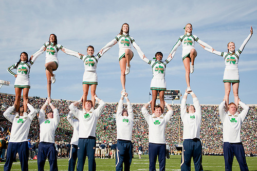 Notre Dame cheerleaders perform during NCAA football game between Tulsa and Notre Dame.  The Tulsa Golden Hurricane defeated the Notre Dame Fighting Irish 28-27 in game at Notre Dame Stadium in South Bend, Indiana.