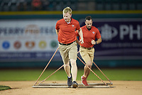 The Fort Wayne TinCaps grounds crew drags the infield between innings of the game against the Bowling Green Hot Rods at Parkview Field on August 20, 2019 in Fort Wayne, Indiana. The Hot Rods defeated the TinCaps 6-5. (Brian Westerholt/Four Seam Images)