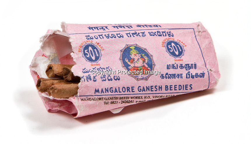 When your tobacco from home runs out it's time to go local. Ganesh Beedies, each one made from a single rolled tobacco leaf - flavoursome