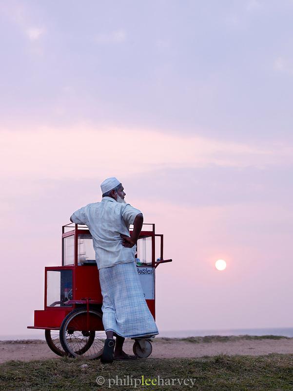 Food seller on the promenade at sunset, Galle, Sri Lanka