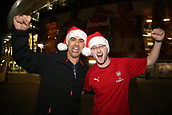2nd November 2017, Emirates Stadium, London, England; UEFA Europa League group stage, Arsenal versus Red Star Belgrade; Arsenal fans posing with Christmas hats outside Emirates Stadium before kick off