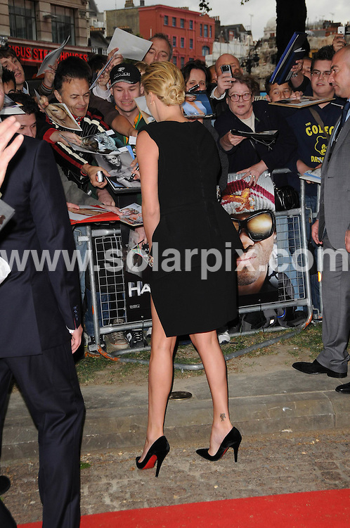 **ALL ROUND PICTURES FROM SOLARPIX.COM**.**WORLDWIDE SYNDICATION RIGHTS**.Guests arrive for the UK premiere of Hancock at the Vue Cinema, Leicester Square, London, UK. Wednesday 18th June 2008..This pic: Charlize Theron..JOB REF: 6679 MSR     DATE: 19_06_2008.**MUST CREDIT SOLARPIX.COM OR DOUBLE FEE WILL BE CHARGED* *UNDER NO CIRCUMSTANCES IS THIS IMAGE TO BE REPRODUCED FOR ANY ONLINE EDITION WITHOUT PRIOR PERMISSION*