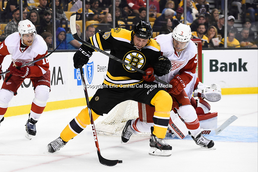 Monday, September 28, 2015, Boston, MA - Detroit Red Wings defenseman Nick Jensen (3) and Boston Bruins left wing Matt Beleskey (39) battle for the puck during the NHL game between the Detroit Red Wings and the Boston Bruins held at TD Garden, in Boston, Massachusetts. Detroit defeats Boston 3-1 in regulation time. Eric Canha/CSM