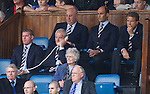 Walter Smith on the phone to the Rangers dugout as he begins his four match ban