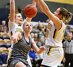 RAPID CITY, SD: DECEMBER 1:  Taylor Molstad #4 of South Dakota Mines tries to fight past Black Hills State defenders Morgan Ham #33 and Remi Wientjes #10 during their Rocky Mountain Athletic Conference women's basketball game Saturday evening at the King Center Rapid City, S.D.  (Photo by Richard Carlson/dakotapress.org)