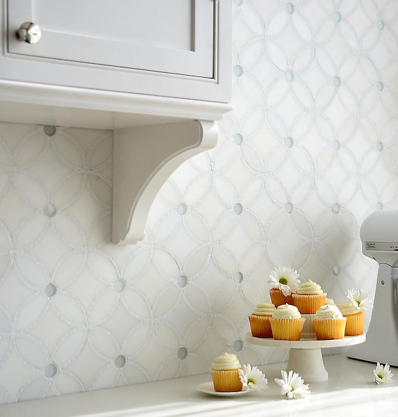Esferitas, a handmade mosaic shown in honed Paperwhite, tumbled Thassos and Tropical White glass. Designed by Paul Schatz for New Ravenna.<br /> <br /> For pricing samples and design help, click here: http://www.newravenna.com/showrooms/
