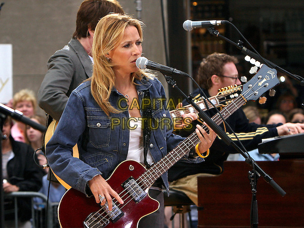 """SHERYL CROW.The """"Today"""" Show's 2004 Concert Series .April 23rd, 2004.half length, half-length, guitar, live, concert, gig, music,  stage, singing.www.capitalpictures.com.sales@capitalpictures.com.Supplied By Capital PIctures"""
