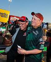 Nov 11, 2018; Pomona, CA, USA; NHRA top alcohol dragster driver James Stevens celebrates with crew members after winning the Auto Club Finals at Auto Club Raceway. Mandatory Credit: Mark J. Rebilas-USA TODAY Sports