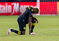 16th July 2020, Orlando, Florida, USA;  Columbus Crew forward Gyasi Zerdes takes a knee before the MLS Is Back Tournament between the Columbus Crew SC versus New York Red Bulls on July 16, 2020 at the ESPN Wide World of Sports, Orlando FL.