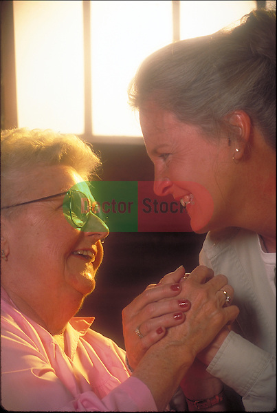 smiling elder with healthcare provider